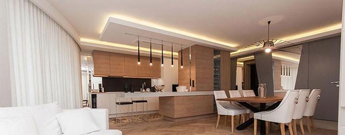 Jak zaplanować praktyczny salon z aneksem kuchennym?